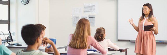 A high schooler giving a presentation to her class.
