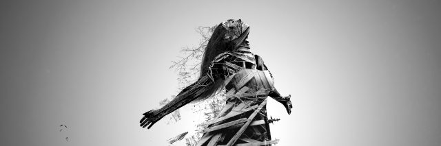 Artistic image of woman made of broken wood looking towards the sky.