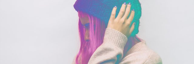 the girl in the hat beanie. the double exposure effect with a gradient