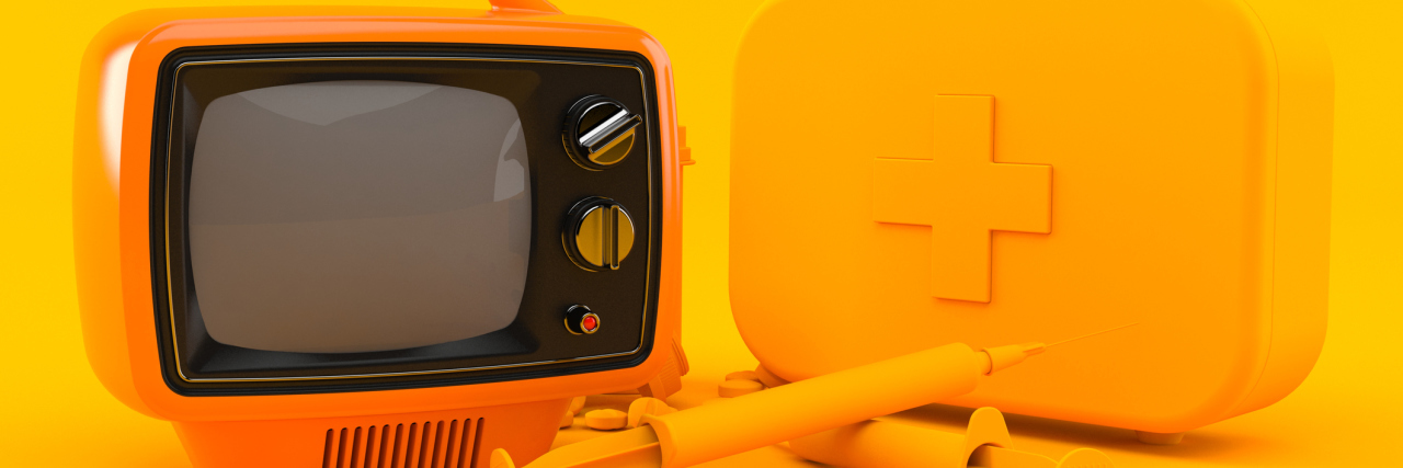 A picture of an orange TV with orange medical supplies, in front of an orange background.