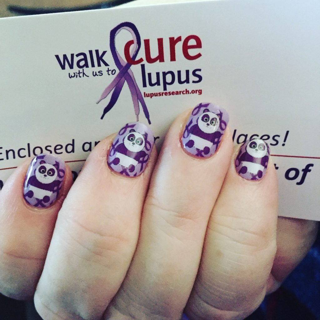 woman holding 'walk with us to cure lupus' paper