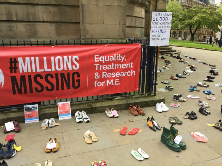 shoes and signs from millions missing event in birmingham, england