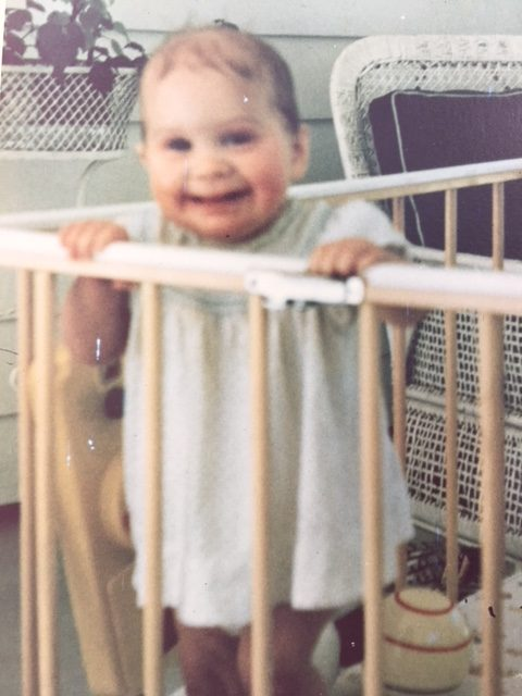 the author as a baby in her crib