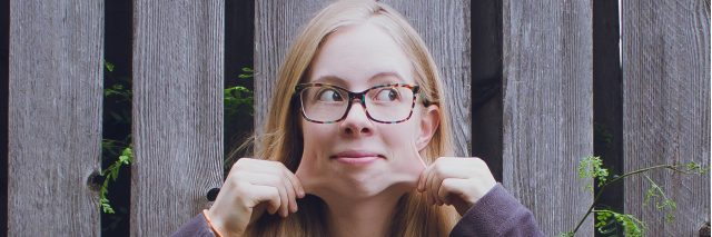 A pictures of the writer pulling on her face's skin, showing how far it stretches.