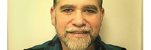 Jason Grant, middle-aged Caucasian man with a gray beard and mustache.