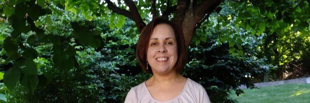 Juana Ortiz standing outdoors.