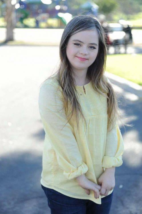 Megan wearing yellow short posing for camera