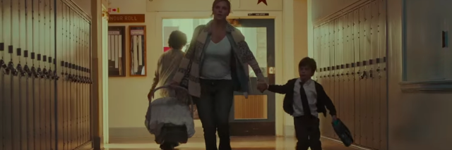 pregnant woman running through school with two children