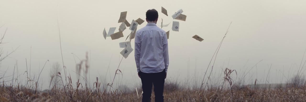 man standing in meadow
