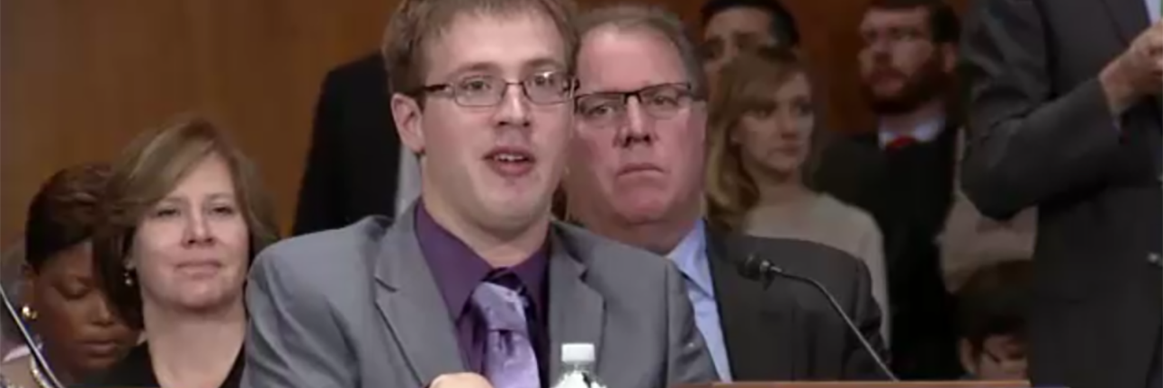 Justin Herbst addresses a Congressional hearing about employment and disability.