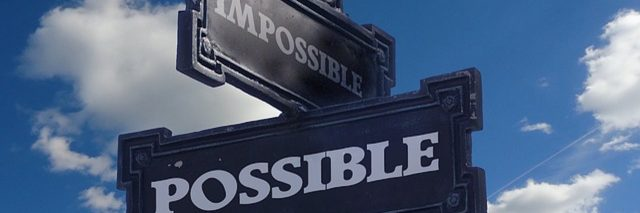 "street signs: one saying ""possible,"" and one saying ""impossible"""