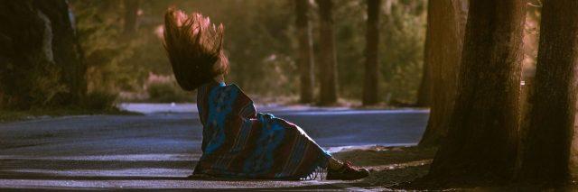 woman falling on street