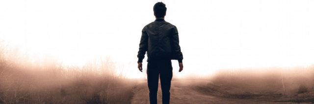 A man walking in a road