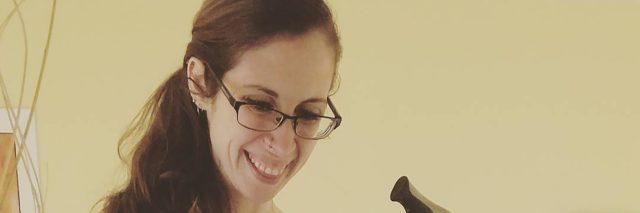 Farrah Kaeser posing for a selfie holding her cane.