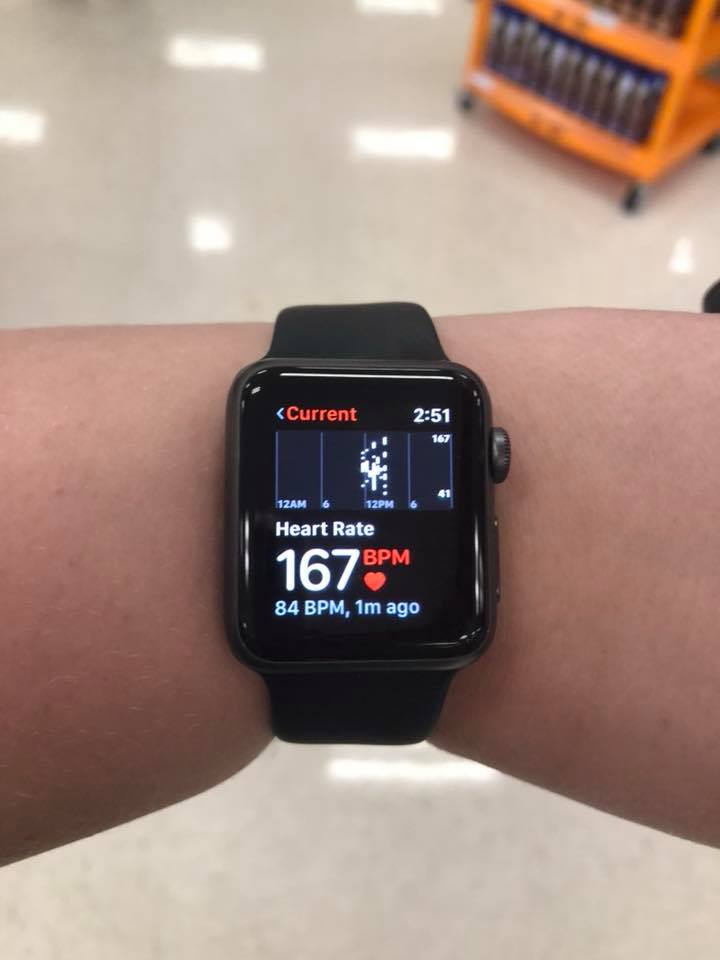 woman's heart rate monitor that reads 167