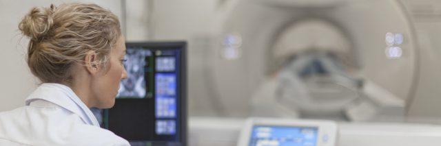 A doctor running an MRI machine.