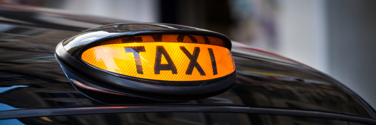 Taxi sign in U.K.