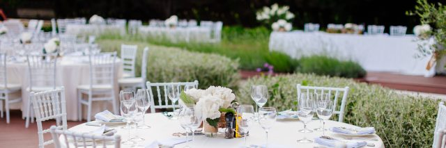 Table set for outdoor wedding reception.