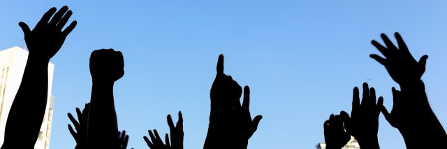 Raised hands at a protest march.