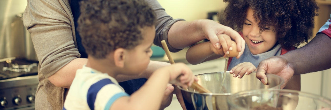 kids helping to stir food in a bowl