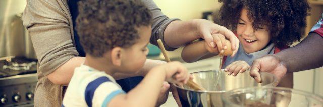 kids helping to stir food in a bowl