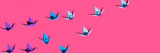 Origami birds on pink