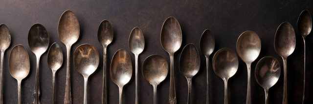A row of vintage looking spoons.