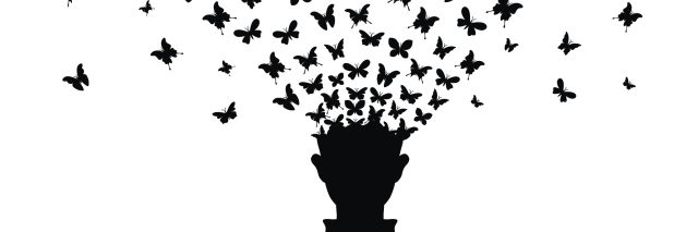 An illustration of a silhouette of a man as his head turns into butterflies flying away.