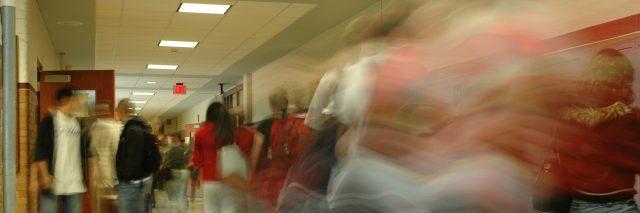 Blurry image of high school hallway