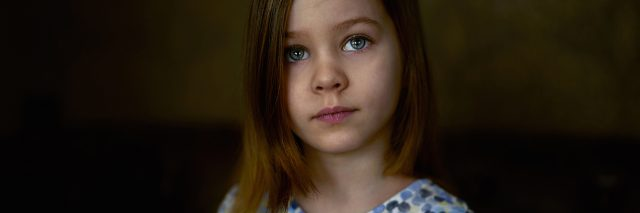 A young girl who looks sad