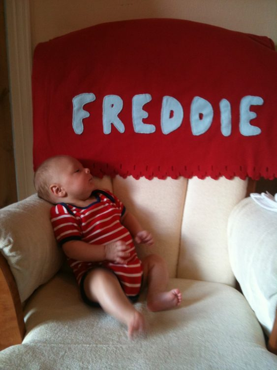 "the author's son sitting on a sofa, with his name ""Freddie"" above him"