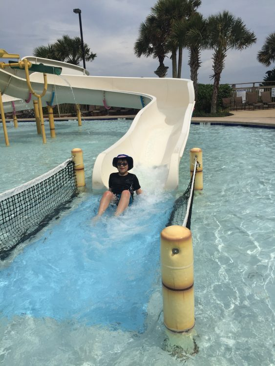 the author's son going down a waterslide