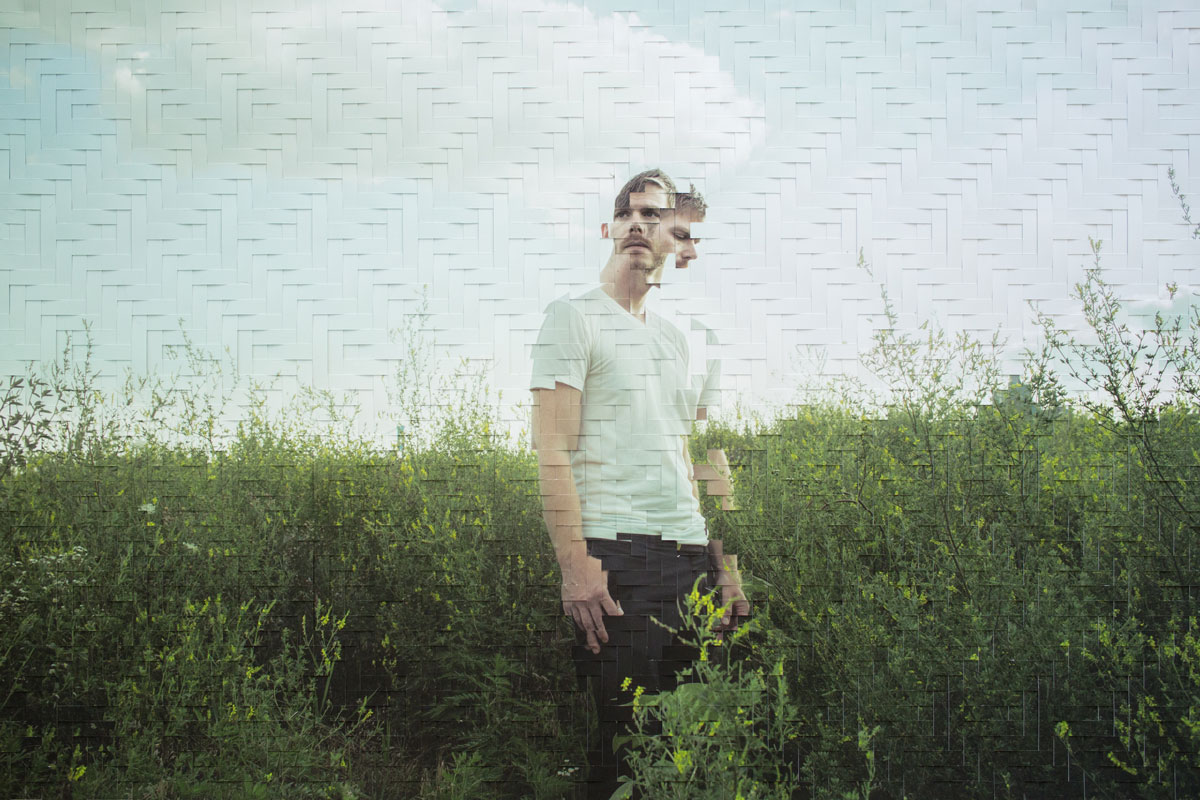 jason chen image of young man standing in field with split face