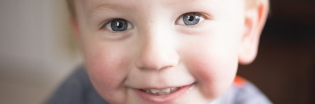 Close up of little boy smiling at camera