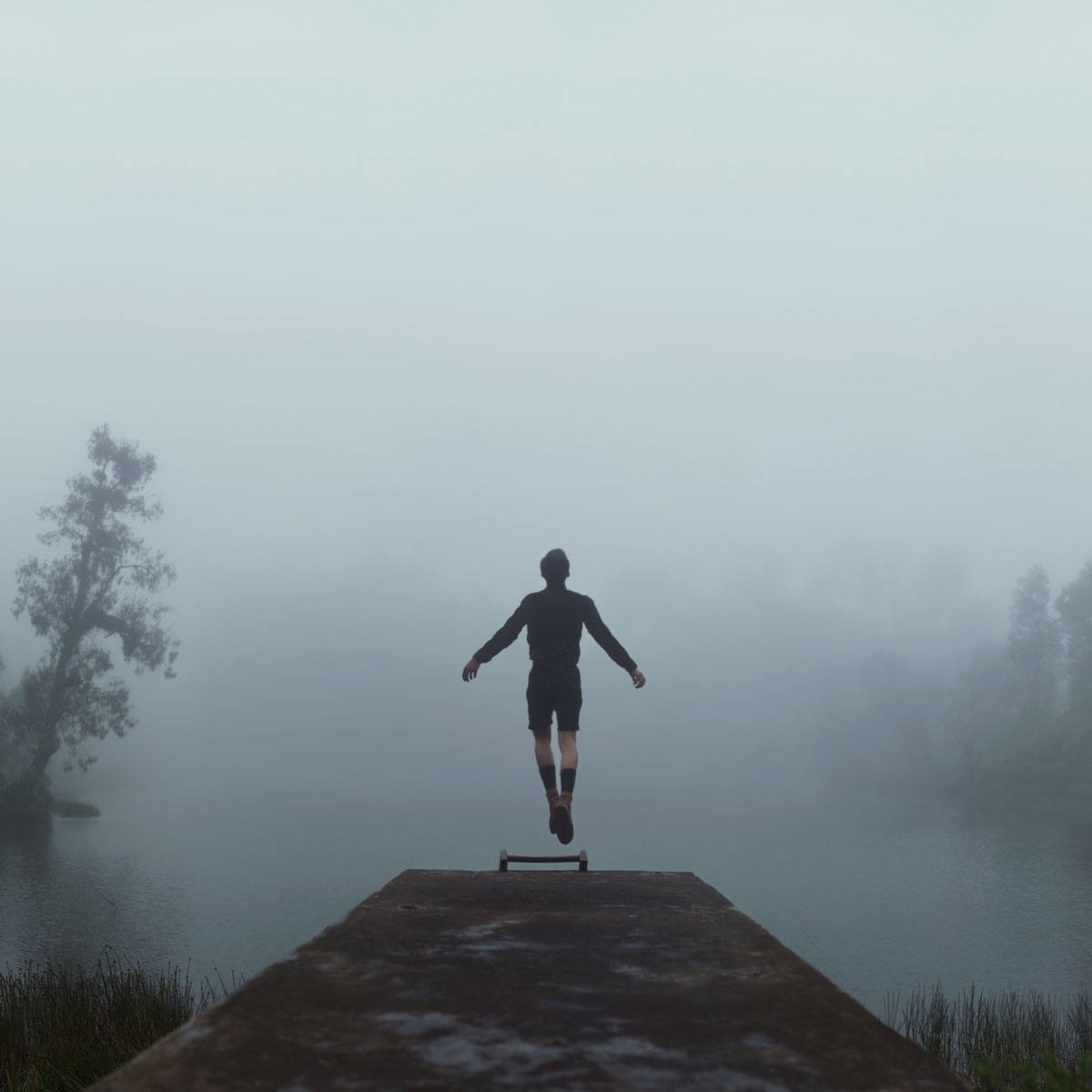 Mikael Aldo photography image of man in front of foggy lake