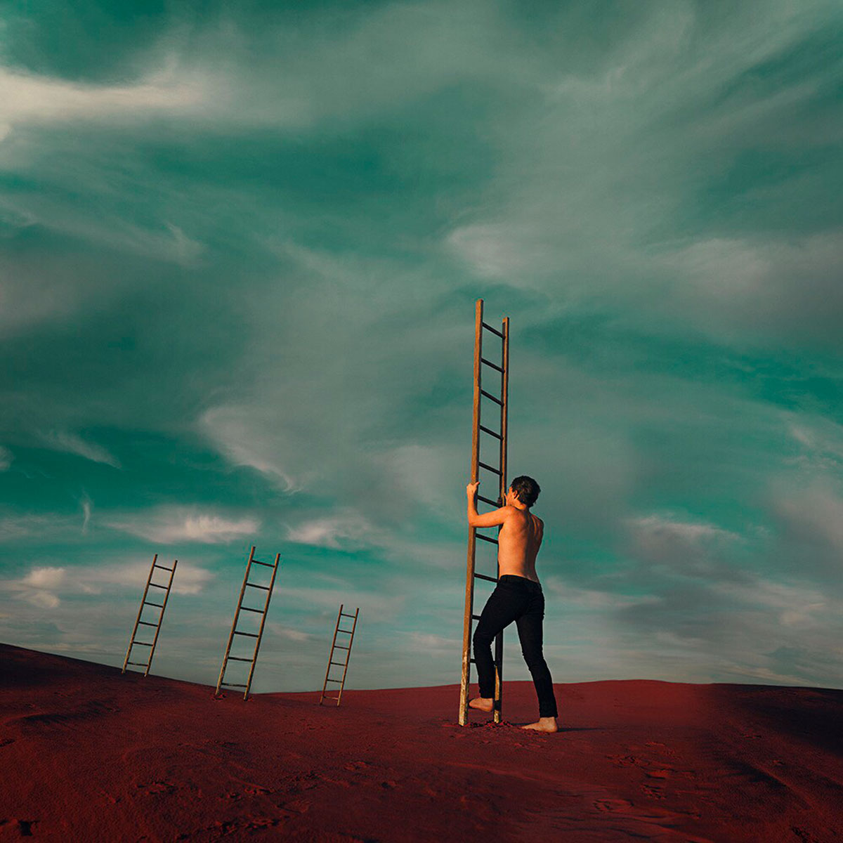 Nathan Milner concept photography digital art image of man climbing ladder into clouds