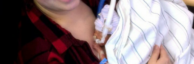 Mother holding preemie baby at hospital. Baby is so small laying on mom's chest