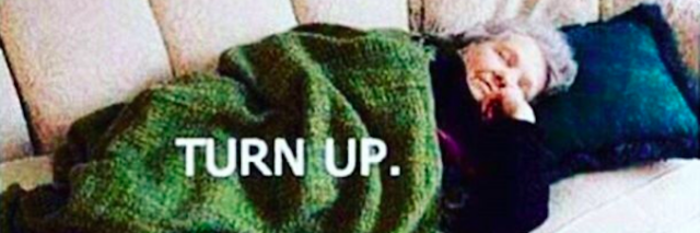 older woman lying on a couch sleeping with text that says 'turn up'