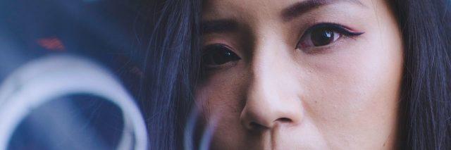 asian woman looking serious at camera close up