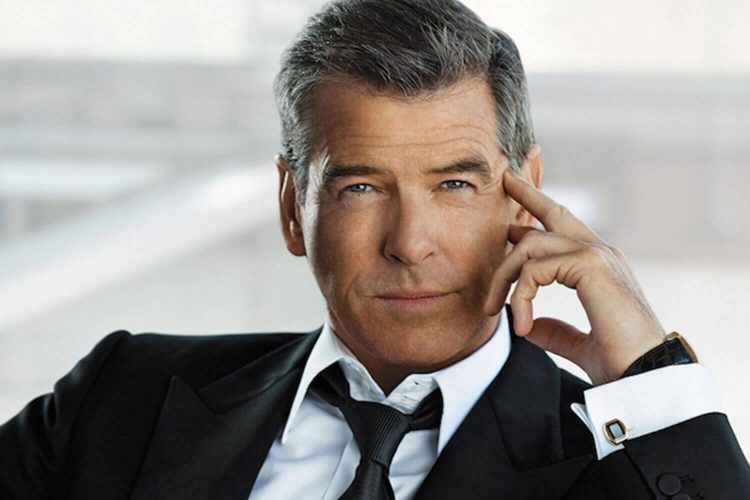 pierce brosnan looking into the camera