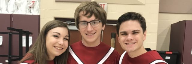 Ryan with his two friends, they are wearing their choir robes