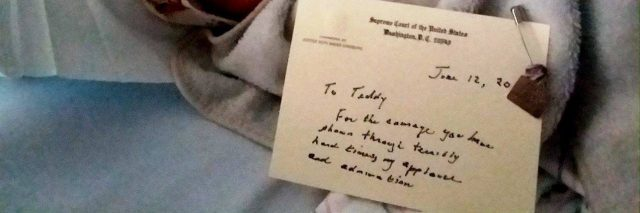 author's son in a hospital bed with a note from Ruth Bader Ginsburg