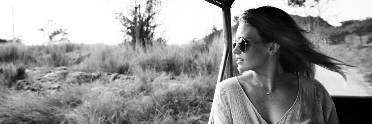 black and white image of woman on safari