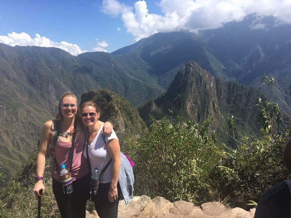 two women posing in front of machu picchu