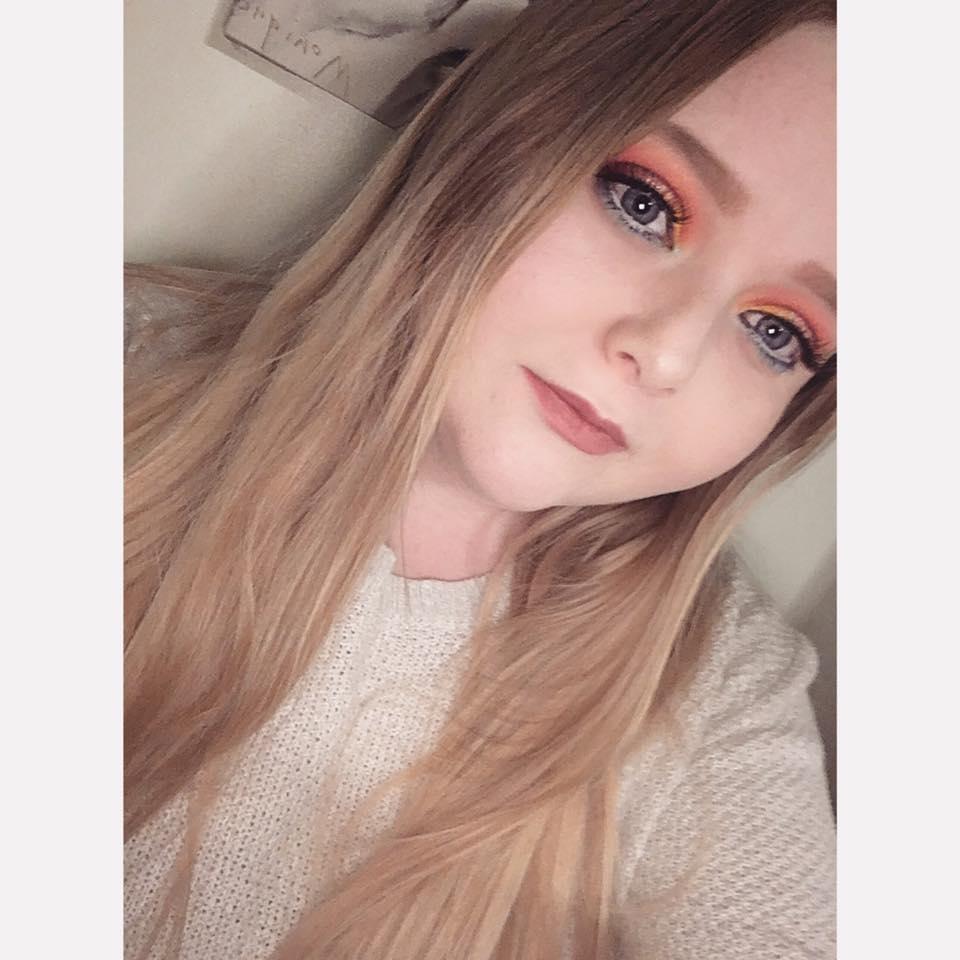 woman taking a selfie wearing makeup