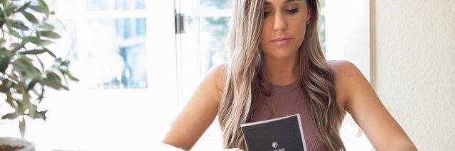 woman looking down at greeting card