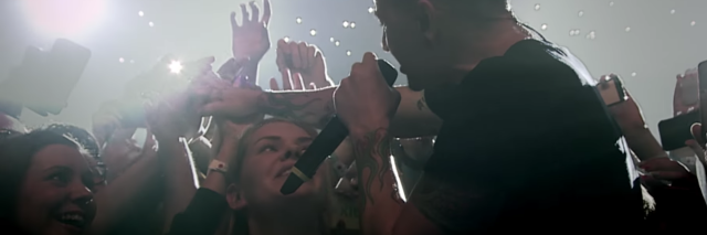 chester bennington in video for one more light with reaching fans