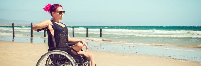 Disabled woman at the beach