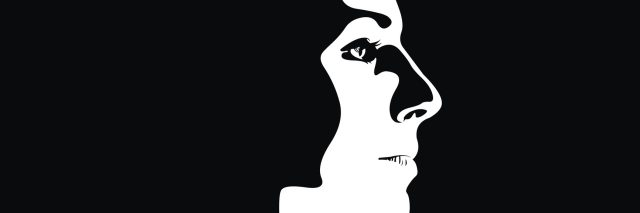 profile view of a woman surrounded by shadow