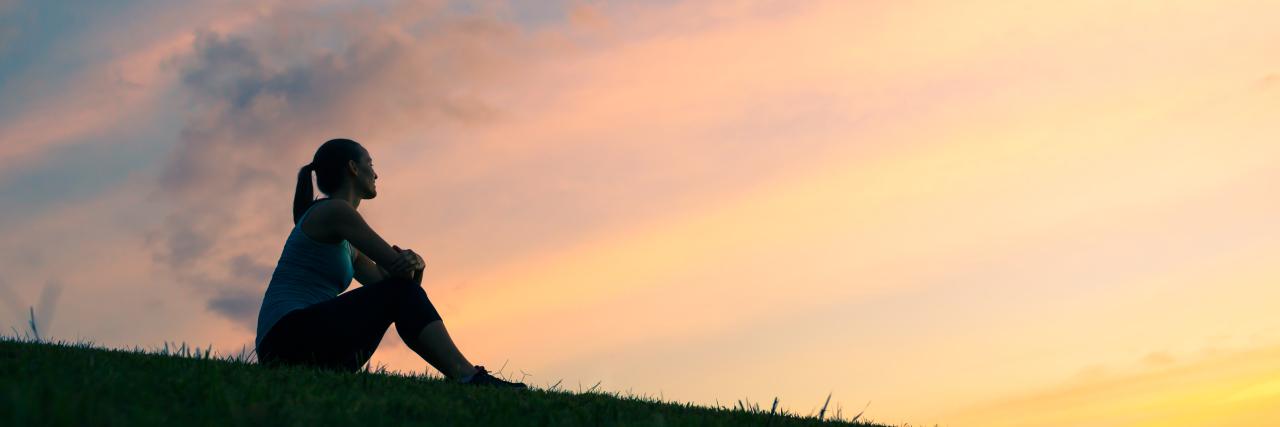 Woman watching sunset.